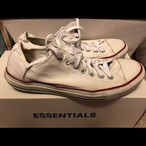 Well-worn white Converse